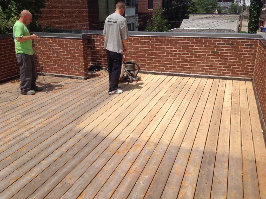 sanding a rooftop deck