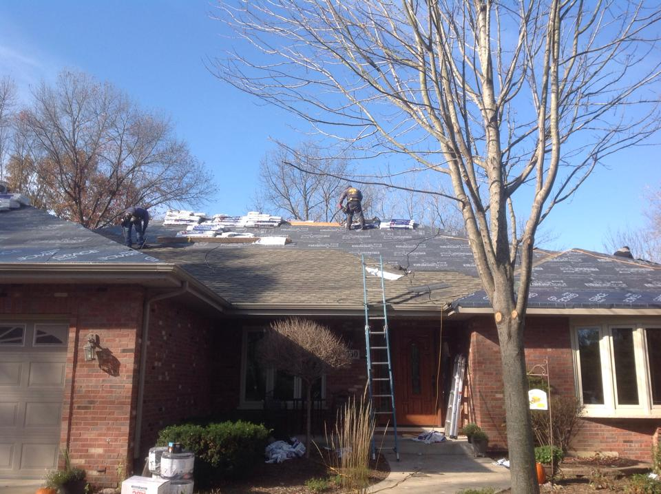 installation of new shingle roof on a brick ranch house