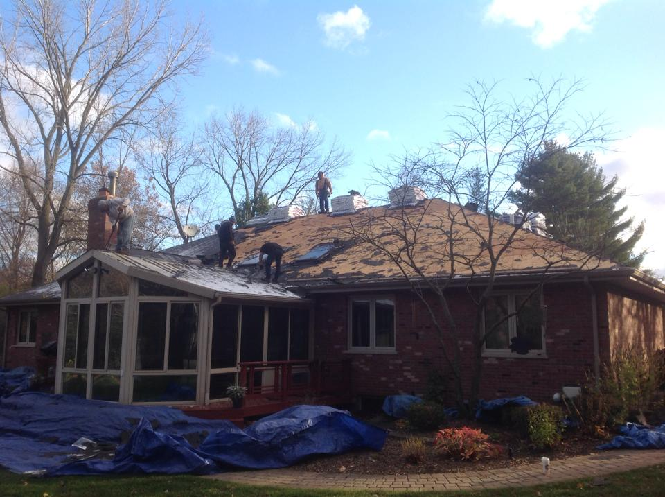removal of old shingle roof from ranch house and enclosed porch, including protective draping around house to avoid damage