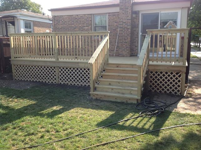 back home deck with wood steps, spindle railing and lattice barrier