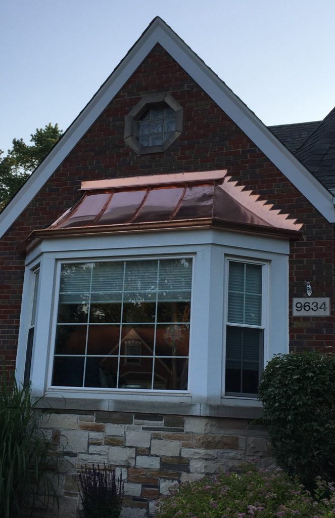 Copper roof, flashing and gutter over bungalow bay window