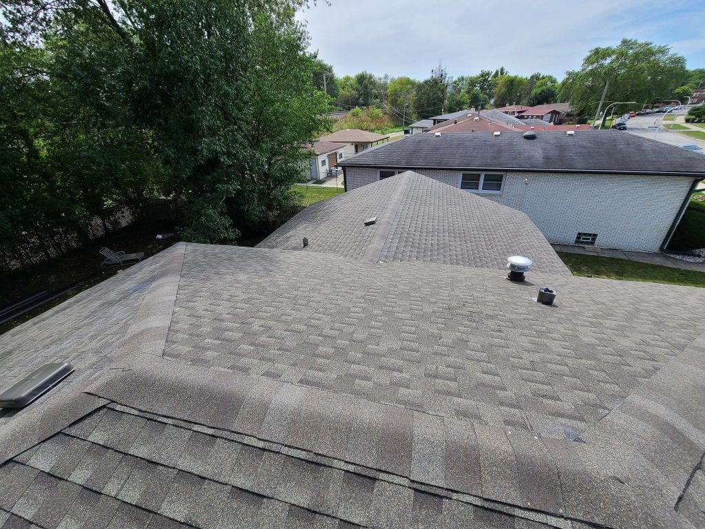view of new shingled roof from top