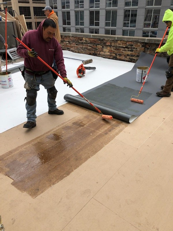 laying base membrane over roof insulation