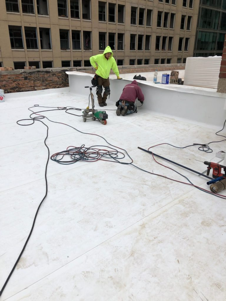 applying membrane to roof firewall