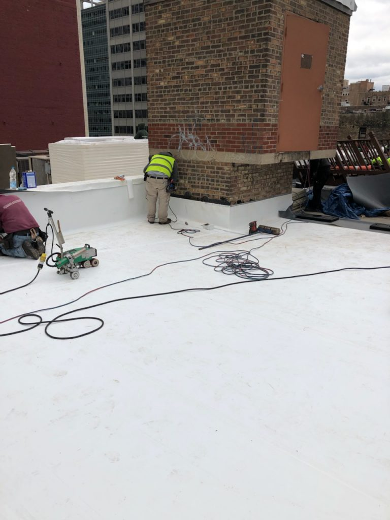 finishing the completed new roof with flashing