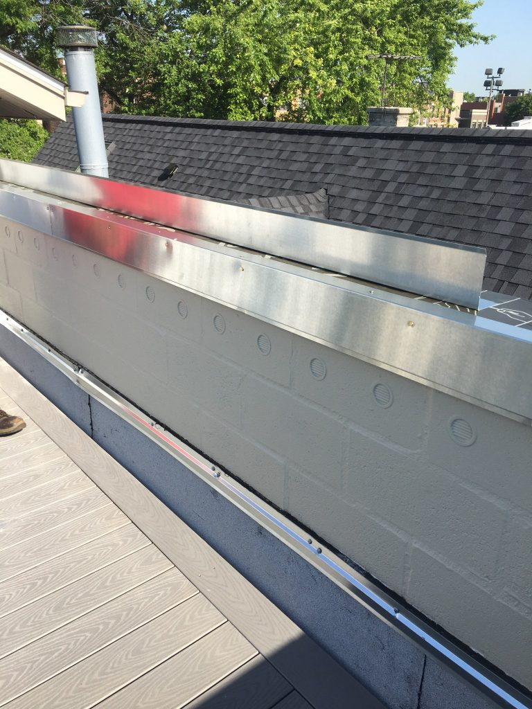 one side of coping installed over membrane, other ready for installation