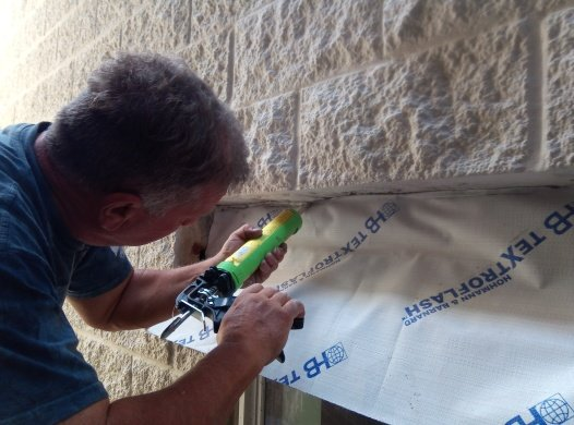sealing the lintel membrane so that lintel will remain dry